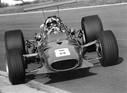 1968_Chris_Amon_sliding_his_Ferrari_312_to_a_2nd_place_finish_at_the_Oulton_Park_track_during_the_1968_International_Gold_Cup.jpg