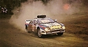 1985_999_008_Attilio_Bettega_-_Maurizio_Perissinot2C_Lancia_037_Rally2C_retired_28229.jpg