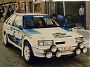 1986_999_006_Ingvar_Carlsson_-_Jan-Olof_Bohlin2C_Mazda_Familia_4WD_Turbo2C_retired0.jpg